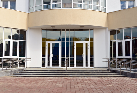 entrance to building with glass doors Stock Photo