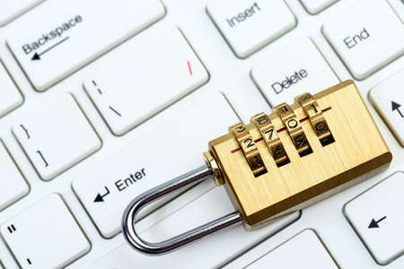 computer and online security with keyboard and padlock