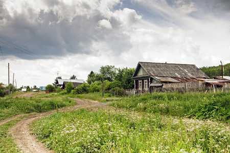 Russian village in summer cloudy day