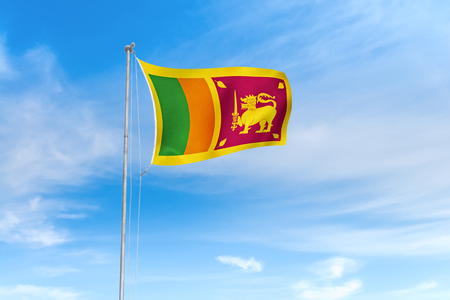 Sri Lanka (Ceylon) flag blowing in the wind over nice blue sky background