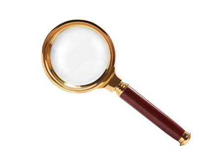 Magnifying glass isolated on white. Old fashioned brass loupe Фото со стока