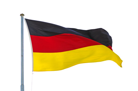 Fluttering German flag on pole in the wind isolated white background photo