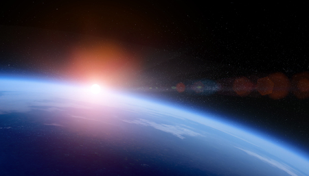 Sunrise over space Earth view from orbit with stars field.