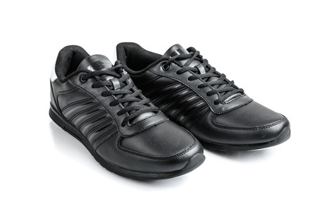 Pair of black sneakers on a white background