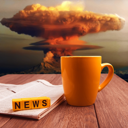 News about nuclear bomb explosion collage image. Mug of coffee and newspaper on wooden table at nuke time