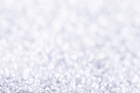 Abstract winter Christmas light blue background with bokeh. Defocused sparkle snow