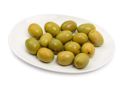 Plate with wet green olives isolated on white background with clipping path