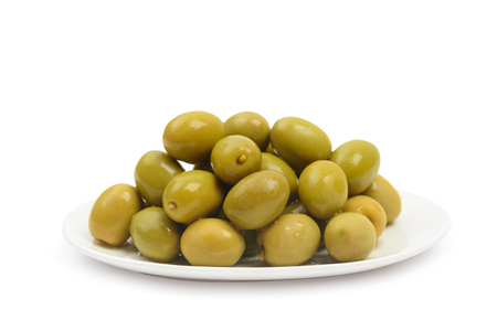Plate with wet green olives isolated on white background with clipping path. Side view Stock Photo - 133307702