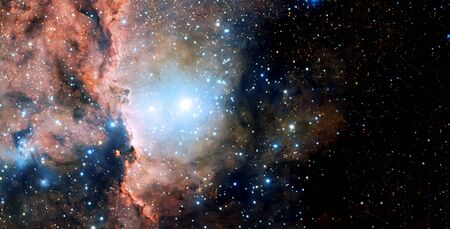 Stars, dust and gas nebula in a far galaxy space background. The infinite universe