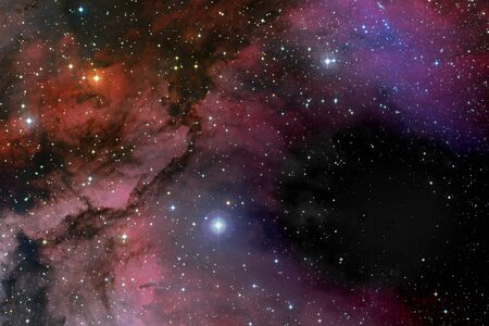 Stars, dust and gas nebula in a far galaxy space background. Stellar nursery. The infinite universe