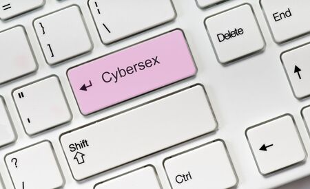 Cybersex pink key button on white keyboard. Online concept