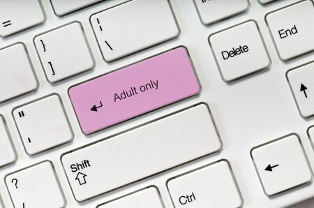 Adult only pink key button on white keyboard. Online sex concept Stock Photo