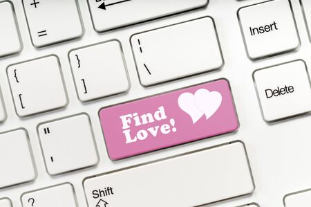 Find Love pink key button on white keyboard concept image Imagens