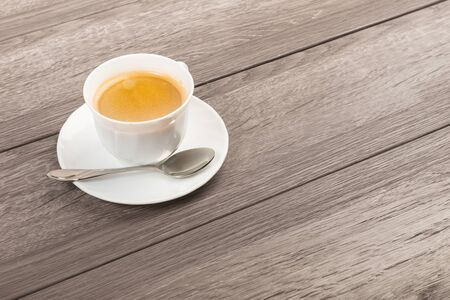 Coffee Cup on Wooden Table with copy space