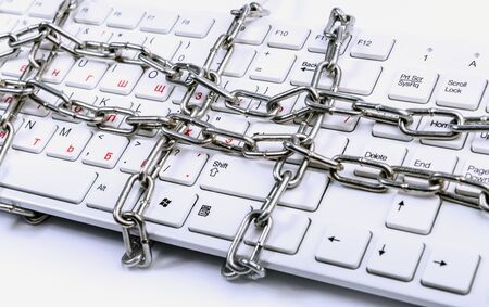 Keyboard locked in chain. Internet freedom concept