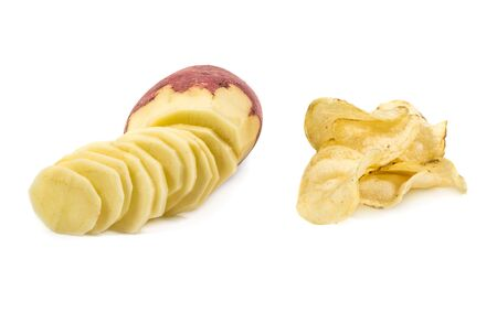 Potatoes chips and raw sliced potato isolated on white