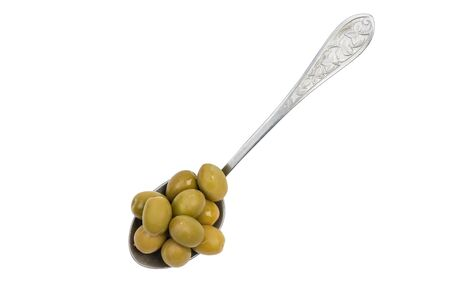 Vintage spoon with green olives isolated on white background