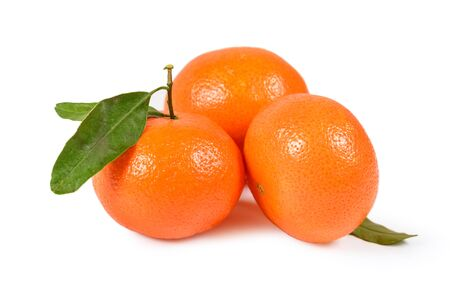 Tangerine or clementine at green leaves isolated on white background isolated with clipping path Imagens