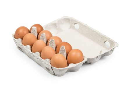 Ten Brown eggs in the cardboard package box high angle view isolated on white. Clipping path for easy cut out