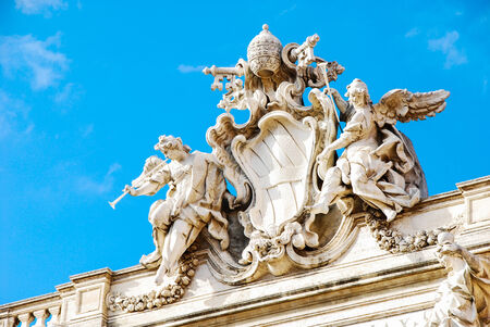 Trevi Fountain in view high. On the blue sky Stock Photo