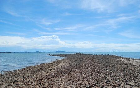 estuary during low tide reveals rocky hills photo