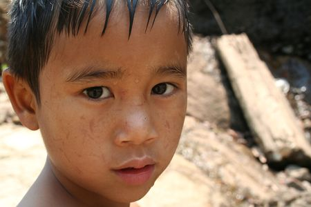 lonely child: Portrait of young asian boy
