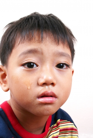 thai boy: Close-up crying boy Stock Photo