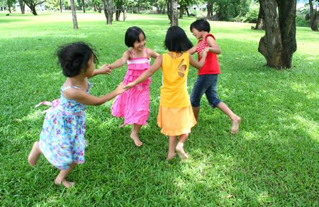 gang: Four girls playing in the park.