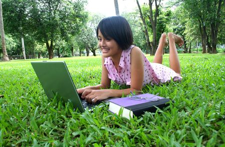 Young teenage learning in the park.