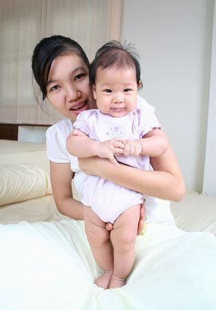 Young asian mother and baby. photo