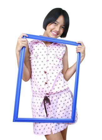 posting: Retrato de ni�a con la publicaci�n de un marco. Foto de archivo