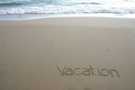 vacation: Vacation, written on the beach.