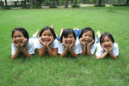 wild asia: Five children playing in the park.