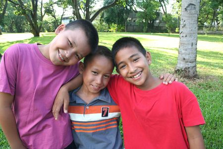 buddies: Three boys having good time in the park Stock Photo