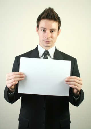 Man holding the white paper.
