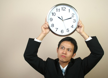Asian business man with clock (series) Stock Photo - 9158725