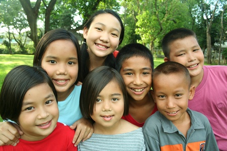 Asian children having fun in the park.