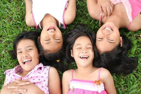 link love: Four children playing in the park.  Stock Photo
