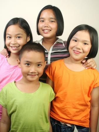 Group of children hanging together