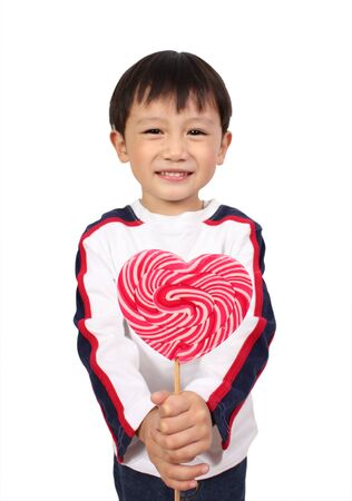 Young boy holding lollipop  Stock Photo - 13383948