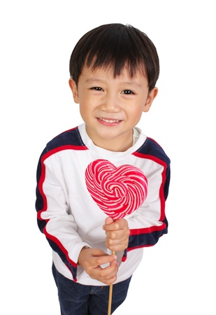lollipops: Young boy holding lollipop  Stock Photo