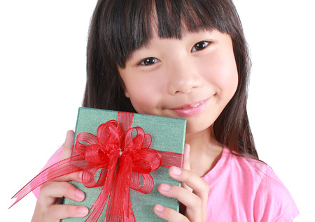Little girl with gift box photo