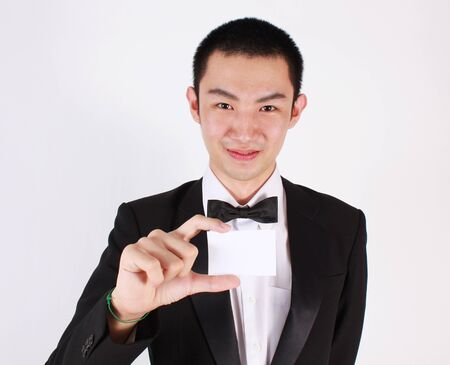 man holding card: Portrait of young asian man holding card.