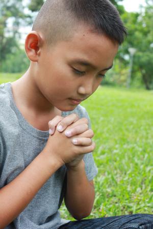 jesus adolescent: Young boy praying.