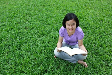 library book: Reading in the park