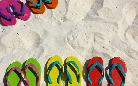 green background pattern: Summer vacation concept--Flipflops on a sandy ocean beach Stock Photo
