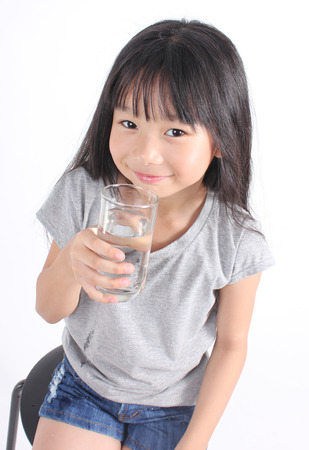 water hand: Young little girl drinking water.