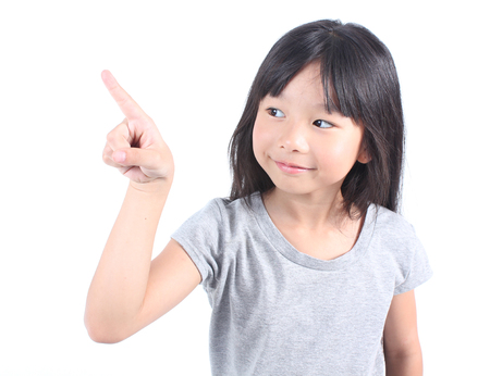 asian children: Little girl pointing up with her finger