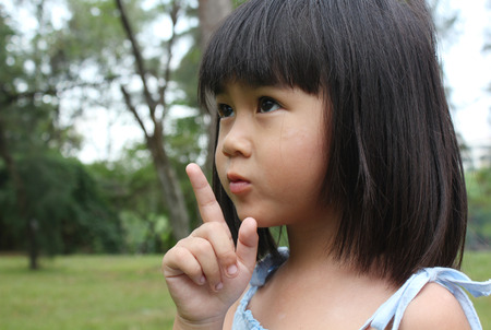 asia children: Portrait of young girl having a good time in the park