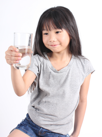 drink water: Young little girl drinking water.